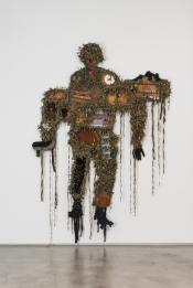 Tony Albert Universal Soldier 2014 assemblage made up of reworked objects fabric and twine 2.73m x 190.5 cm x 5.5 cm 1